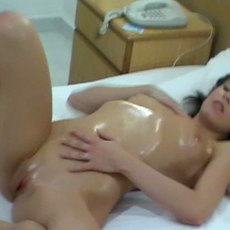 The salacious brunette amateur is masturbating the pussy in the hotel shower