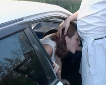Hot red girl in light dress is fucking in and near the car