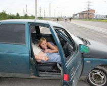 Naughty amateur chick fucking a strange guy in his car