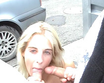 An attractive blonde on the car wash practices sex for money.